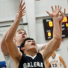 Galena's Nick Sarwinski (22) battles Riverton's Trevor Parsons for a rebound during their game on Friday night at RHS.<br /> Globe | Laurie Sisk