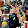 Missouri Southern's Cam Martin (31) scores over Pittsburg State's Christian Edmondson (33) during their game on Saturday at PSU.<br /> Globe | Laurie SIsk