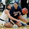 Missouri Southern's Layne Skiles, left, battles Rogers State's Alicia Brown (10) during their game on Saturday at Leggett & Platt.<br /> Globe | Laurie Sisk
