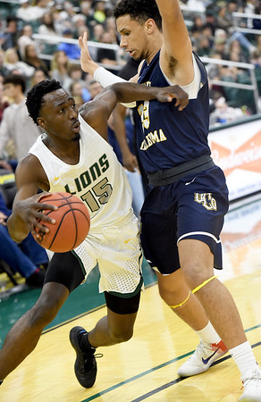 Missouri Southern's Elyjah Clark (15) fights his way around Central Oklahoma's Cam Givens (33) during their game on Thursday night at Leggett & Platt.<br /> Globe | Laurie Sisk