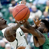 Missouri Southern's Elyjah Clark, left drives to the basket as Northeastern State's John Ihek defends during their game on Wednesday night at Leggett & Platt.<br /> Globe | Laurie Sisk