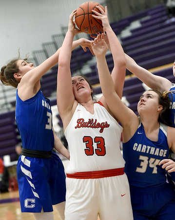 Carl Junction's Katie Scott (33) battles Carthage's Hailey Fullerton (35) and Jordan Miller (34) for a rebound during their semifinal game of the 2020 Bill Hanson Memorial Tournament on Friday at Pittsburg High School.<br /> Globe | Laurie Sisk