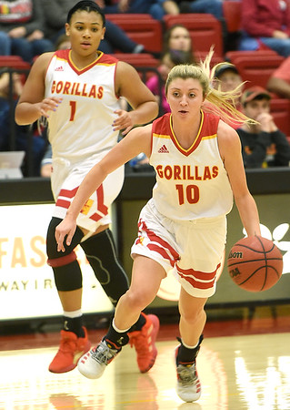 Pittsburg State's Tristan Gegg (10) dribbles the ball downcourt as teammate Maya Williams (1) looks on during their game against Missouri Southern on Saturday.<br /> Globe   Laurie SIsk