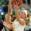 Missouri Southern's Emily Kuntze (21) drives to the basket as Northeastern State's Shae Sanchez defends during their game on Wednesday night at Leggett & Platt.<br /> Globe | Laurie Sisk