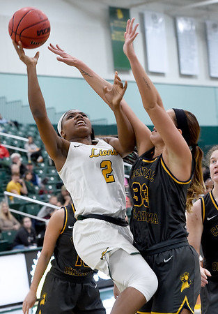 Missouri Southern's Chasidee Owens (2) drives to the basket as Central Oklahoma's Kelsey Johnson (33) defends during their game on Thursday night at Leggett & Platt.<br /> Globe | Laurie Sisk