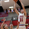 Webb City's Luke Brumit (31) shoots over Cassville's Jarrod Wallace as Dane Martin (24) looks on during their game on Friday night at the Cardinal Dome.<br /> Globe | Laurie Sisk