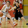 Carl Junction's Destiny Buerge (23) beats Republic's Kaitlyn Ragsdale to a loose ball during their game on Thursday night at CJHS.<br /> Globe | Laurie Sisk