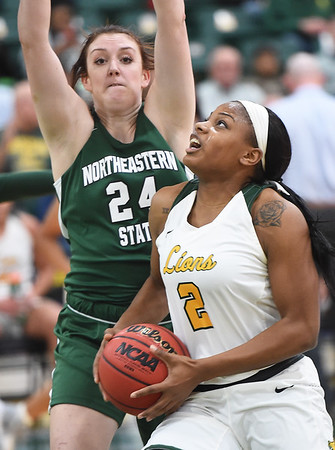 Missouri Southern's Chasidee Owens (2) drives to the basket as Northeastern State's Morgan Hellyer (24) defends during their game on Wednesday night at Leggett & Platt.<br /> Globe | Laurie Sisk