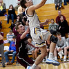 Thomas Jefferson's Chase Kellenberger (32)) scores in transition as Wheaton's Zac Leverich (30) defends during their game on Tuesday night at TJ.<br /> Globe | Laurie Sisk
