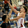 Joplin's Dakarai Allen (4) drives to the basket as Jefferson City's Sterling DeSha (15) defends during their game in the opening round of the Kaminsky Classic on Thursday at JHS.<br /> Globe | Laurie Sisk