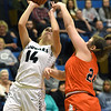 College Heights' Grace Bishop (14) scores over Jasper's Addy Prim (24) during their game on Fridat night at Ozark Christian College.<br /> Globe | Laurie Sisk