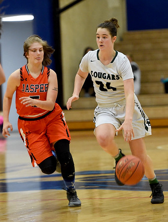 College Heights' Emmy Colin (24) looks to get past Jasper's Sydney Webb (5) during their game on Friday night at Ozark Christian College.<br /> Globe | Laurie Sisk