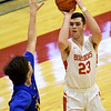 Carl Junction's Alex Baker (23) puts up a shot as Francis Howell's Chase Engelhard defends during their game in the opening round of the Kaminsky Classic on Thursday at JHS.<br /> Globe | Laurie Sisk