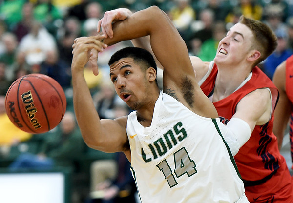 Missouri Southern's Christian Bundy (14) battle Rogers State's Jett Sternberger for a rebound during their game on Saturday at Leggett & Platt.<br /> Globe | Laurie Sisk