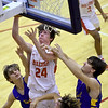 Carl Junction's Blake Poorman (24) splits Francis Howell defenders Shane Kearbey, left and Chase Engelhard during their game in the opening round of the Kaminsky Classic on Thursday at JHS.<br /> Globe | Laurie Sisk
