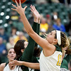 Missouri Southern's Amber Buch (11) drives to the basket as Northeastern State's Britney Ho defends during their game on Wednesday night at Leggett & Platt.<br /> Globe | Laurie Sisk
