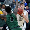Missouri Southern's Cam Martin (31) looks to get past as Northeastern State's John Ihek (3) during their game on Wednesday night at Leggett & Platt.<br /> Globe | Laurie Sisk