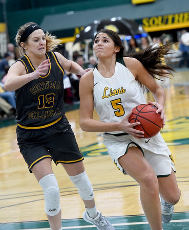 Missouri Southern's Layne Skiles (5) tries to get past Central Oklahoma's McKenna Pulley (12) during their game on Thursday night at Leggett & Platt.<br /> Globe | Laurie Sisk