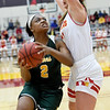 Missouri Southern's Chasidee Owens (2) drives the lane as Pittsburg State's Julia Johnson defends during their game on Saturday at PSU.<br /> Globe | Laurie SIsk