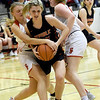 Carl Junction's Shila Winder, left and Taylor Hughes, right, battle Republic's Kaemyn Bekemeier for a rebound during their game on Thursday night at CJHS.<br /> Globe | Laurie Sisk