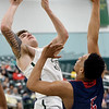 Missouri Southern's Cam Martin (31) scores over Newman's Madison Birnbaum (5) during the first half of their game on Saturday at Leggett & Platt.<br /> Globe | Laurie Sisk