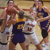 Carl Junction's Dani Wrensch (5) and Shila Winder (12) block a shot from Monett's Kaesha George during Monday's game in Carl Junction.<br /> Globe | Roger Nomer