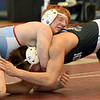 Webb City's Jackson Ward, left, battles Joplin's Drew Van Glider during their 152 lb. match on Saturday at JHS.<br /> Globe | Laurie Sisk