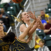 Missouri Southern's Zoe Campbell is fouled by Central Oklahoma's Micayla Haynes (34) during their game on Thursday night at Leggett & Platt.<br /> Globe | Laurie Sisk