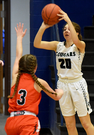 College Heights' Klohe Burk (20) shoots over Jasper's Alexis Durman (3) during their game on Friday night at Ozark Christian College.<br /> Globe | Laurie Sisk