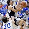 Galena's Brett Sarwinski (10) splits Riverton defenders Carter Brown (3) and Trevor Parsons for a score during their game on Friday night at RHS.<br /> Globe | Laurie Sisk