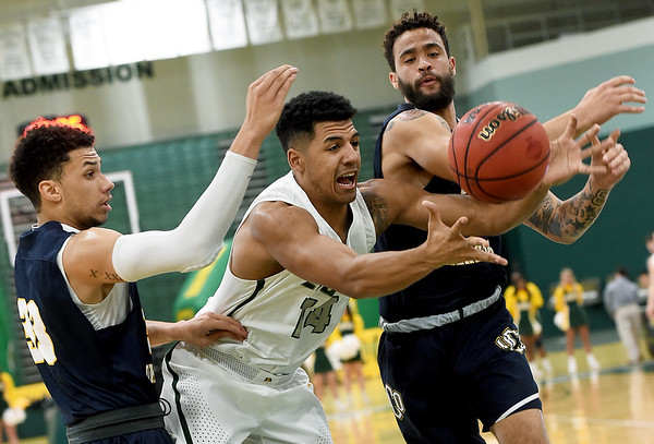 Missouri Southern's Christian Bundy (14) battles Central Oklahoma's Cam Givens (33) and Dashawn McDowell for the ball during their game on Thursday night at Leggett & Platt.<br /> Globe | Laurie Sisk