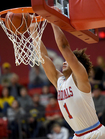 Webb City's Terrell Kabala buries a dunk after driving the baseline during the Cardinals game against Cassville on Friday night at the Cardinal Dome.<br /> Globe | Laurie Sisk