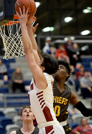 Joplin's Tommy Hafer, left goes to the basket as Kickapoo's Terrell Gladney defends during their game on Tuesday night at Kaminsky Gymnasium.<br /> Globe | Laurie Sisk