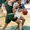 Missouri Southern's Reggie Tharp tries to drive past Northeastern State's Iaian McLaughlin (15)  during their game on Wednesday night at Leggett & Platt.<br /> Globe | Laurie Sisk