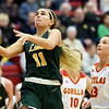 Missouri Southern's Amber Buch (11) drives past Pittsburg State's Sydnee Crain (23) during their game on Saturday at PSU.<br /> Globe | Laurie SIsk