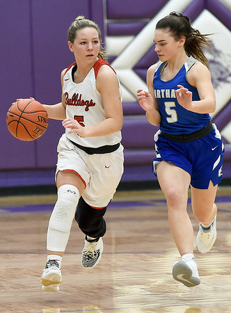 Carl Junction's Dani Wrensch, left, works to get past Carthage's Katie Crowe during their semifinal game of the 2020 Bill Hanson Memorial Tournament on Friday at Pittsburg High School.<br /> Globe | Laurie Sisk