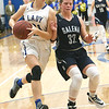 Riverton's Jacy Thomasson (31) tries to get past Galena's Kierra Hall (34) during their game on Friday night at RHS.<br /> Globe | Laurie Sisk