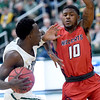 Missouri Southern's Elyjah Clark (15) tries to get past Rogers State's Tavian Davis (10) during their game on Saturday at Leggett & Platt.<br /> Globe | Laurie Sisk