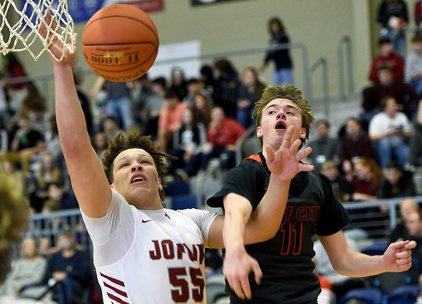 Joplin's Isaiah Davis (55) drives to the basket as Jefferson City's Brennen Jeffries (11) defends during their game in the opening round of the Kaminsky Classic on Thursday at JHS.<br /> Globe | Laurie Sisk