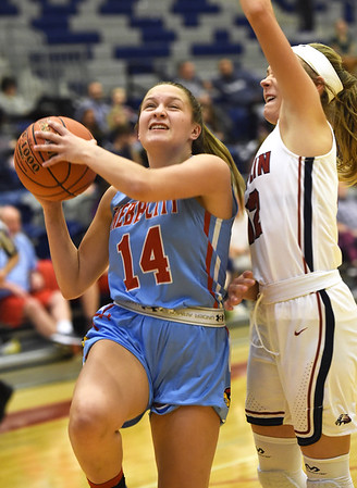 Webb City's Jaydee Duda (14) gets past Joplin's Gabriella Quinnn (12) for a score during their game on Tuesday night at Kaminsky Gymnasium.<br /> Globe | Laurie Sisk