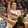 Carl Junction's Katie Scott (33) scores over Republic's Shealyn Barrett (25) during their game on Thursday night at CJHS.<br /> Globe | Laurie Sisk