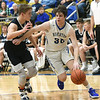 Riverton's Carter Brown (30) works to get past Galena's Garrett Lawson (15) during their game on Friday night at RHS.<br /> Globe | Laurie Sisk
