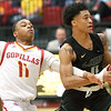 Pittsburg State's Marcel Cherry (11) tries to strip the ball from Missouri Southern's Reggie Tharp (0) during their game on Saturday at PSU.<br /> Globe | Laurie SIsk