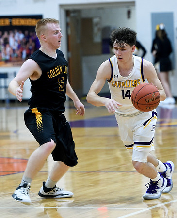 Thomas Jefferson's Dylan Dean-Heck looks to get past Golden City's Ryan Sheets (5) during their game on Thursday night at Thomas Jefferson.<br /> Globe | Laurie Sisk