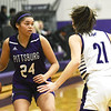 Pittsburg's Jaya Minnifield (24) looks for an open teammate as Blue Valley Northwest's Emily Farthing (21) defends during their consolation semifinal game of the 2020 Bill Hanson Memorial Tournament on Friday at Pittsburg High School.<br /> Globe | Laurie Sisk
