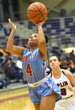 Webb City's Sierra Kmbrough (4) gets past Joplin's Jacie Jensen (10) during their game on Tuesday night at Kaminsky Gymnasium.<br /> Globe | Laurie Sisk