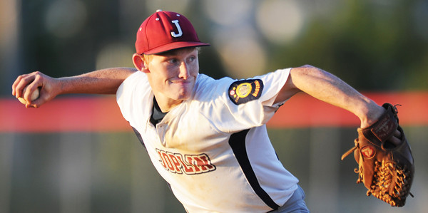 Globe/T. Rob Brown<br /> Joplin Miners pitcher winds up for the throw to the plate against Webb City Friday evening, July 20, 2012, during American Legion baseball championship tournament in Webb City.