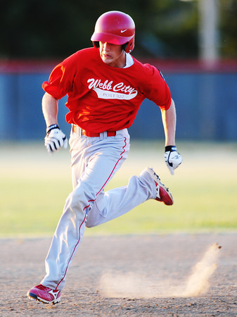 Globe/T. Rob Brown<br /> Webb City (30) heads toward third base before scoring a run against Joplin Friday evening, July 20, 2012, during American Legion baseball championship tournament in Webb City.