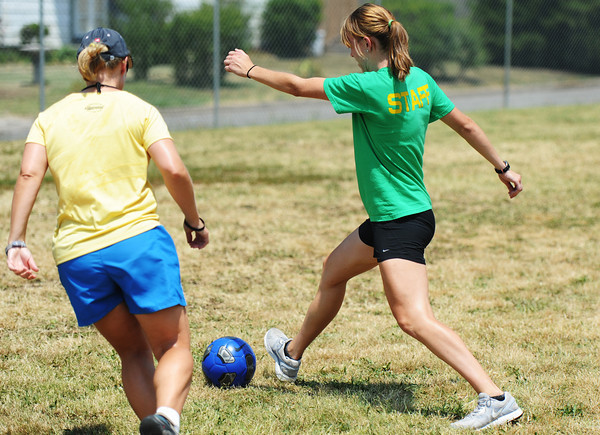 Globe/T. Rob Brown<br /> Courtney Wood, right, of Neosho, plays a game of soccer with students and other Boys and Girls Club of Southwest Missouri employees Thursday afternoon, July 13, 2012.