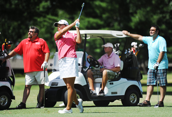 Globe/T. Rob Brown Irene Cho, LPGA golfer from Fullerton, Calif., watches her ball fly from the fairway as a team, including (from left) Chris Baker, of Webb City, Dan Hartley (behind Cho), of Joplin, Randy Brownlow, of Joplin, and Jamie Vangel, of Joplin, look on during the Mercy LPGA Pro Am Monday morning, July 2, 2012, at Twin Hills Country Club and Golf Course. Vangel and Baker are with J. Vangel Electric, of Joplin, and Brownlow and Hartley, are with Joplin Supply.